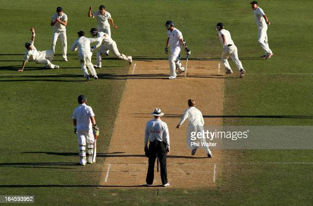 Tim Southee of New Zealand takes a catch to dismiss Steven Finn of England during day four of the Third Test match between New Zealand and England at...