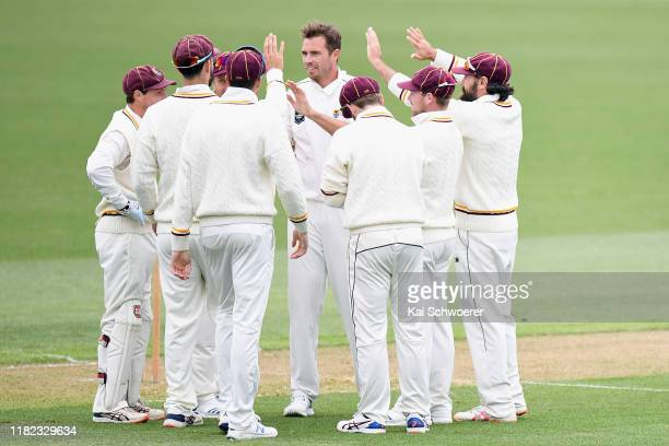 Tim Southee of Northern Districts is congratulated by team mates after dismissing Stephen Murdoch of Canterbury during the Plunket Shield match...