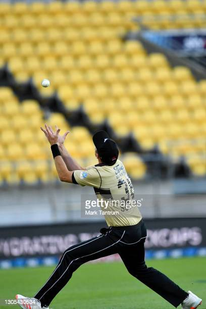 Tim Southee of the Black Caps catches out Josh Philippe of Australia during game four of the International T20 series between New Zealand Blackcaps...