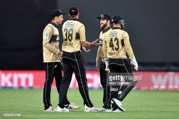 Tim Southee of the Black Caps is congratulated by teammates for catching out Matthew Wade of Australia during game four of the International T20...
