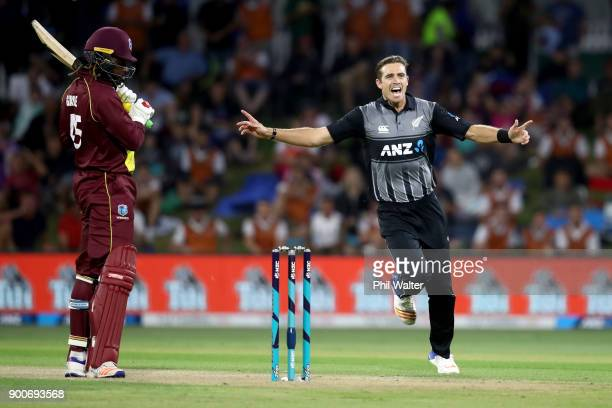 Tim Southee of the New Zealand Black Caps bats celebrates his wicket of Chris Gayle of the West Indies during game three of the Twenty20 series...