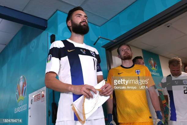Tim Sparv and Lukas Hradecky of Finland wait to make their way towards the pitch prior to the UEFA Euro 2020 Championship Group B match between...