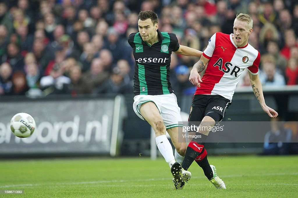 Tim Sparv of FC Groningen, Lex Immers of Feyenoord during the Dutch Eredivise match between Feyenoord and FC Groningen at stadium De Kuip on December 23, 2012 in Rotterdam, The Netherlands.