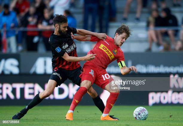 Tim Sparv of FC Midtjylland and Mathias Jensen of FC Nordsjælland compete for the ball during the Danish Alka Superliga match between FC Midtjylland...