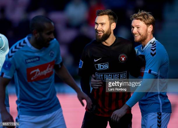 Tim Sparv of FC Midtjylland laughing with Christian Jakobsen of Sonderjyske during the Danish Alka Superliga match between FC Midtjylland and...