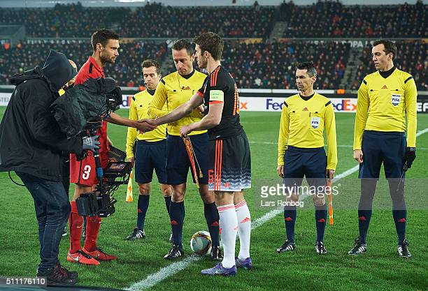Tim Sparv of FC Midtjylland shake hands with Michael Carrick of Manchester United prior to the UEFA Europa League match between FC Midtjylland and...