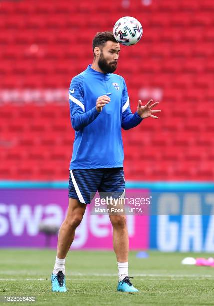 Tim Sparv of Finland heads the ball during the Finland Training Session ahead of the UEFA Euro 2020 Championship Group B match between Denmark and...