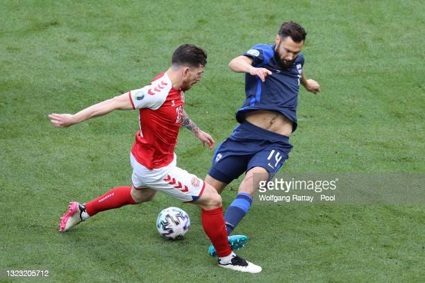 Tim Sparv of Finland is challenged by Pierre-Emile Hojbjerg of Denmark during the UEFA Euro 2020 Championship Group B match between Denmark and...