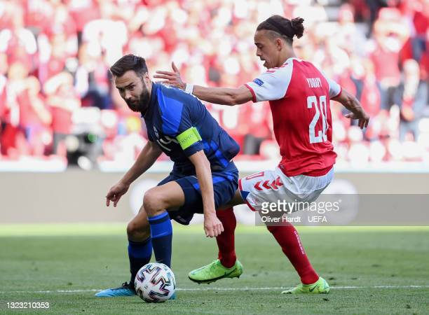 Tim Sparv of Finland is closed down by Yussuf Poulsen of Denmark during the UEFA Euro 2020 Championship Group B match between Denmark and Finland on...