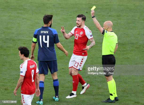 Tim Sparv of Finland is shown a yellow card by Match Referee, Anthony Taylor as Pierre-Emile Hojbjerg of Denmark reacts during the UEFA Euro 2020...
