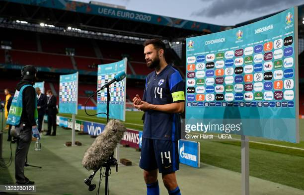 Tim Sparv of Finland looks on as they are interviewed following the UEFA Euro 2020 Championship Group B match between Denmark and Finland on June 12,...