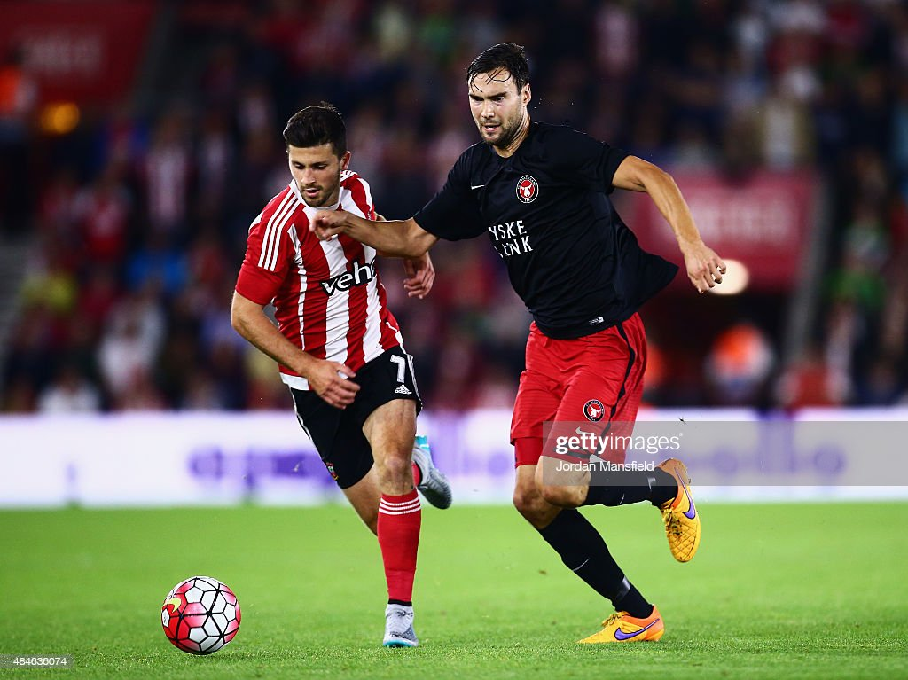 Tim Sparv of Midtjylland challenges for the ball with Shane Long of Southampton during the UEFA Europa League Play Off Round 1st Leg match between Southampton and Midtjylland at St Mary's Stadium on August 20, 2015 in Southampton, England.