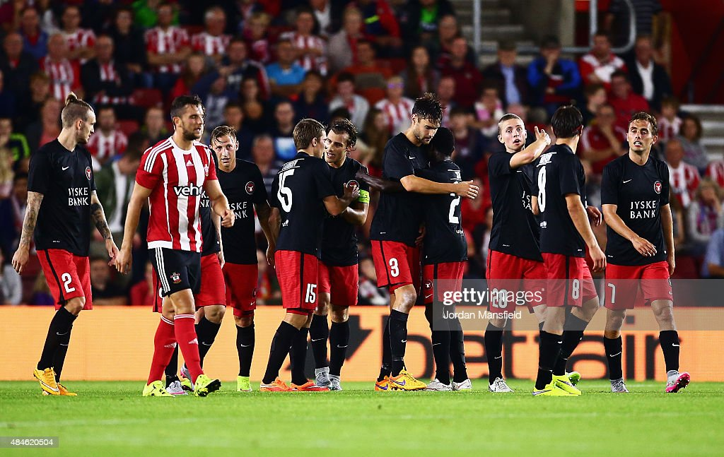 Tim Sparv (#3) of Midtjylland is congratulated by team mates after scoring the opening goal during the UEFA Europa League Play Off Round 1st Leg match between Southampton and Midtjylland at St Mary's Stadium on August 20, 2015 in Southampton, England.