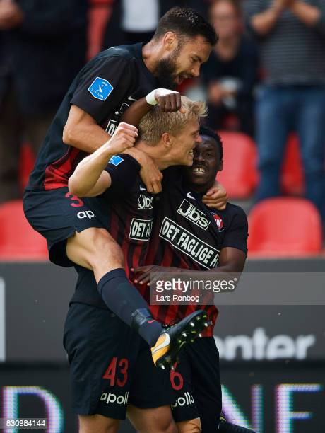Tim Sparv Rasmus Nissen and Rilwan Hassan of FC Midtjylland celebrate after scoring their second goal during the Danish Alka Superliga match between...