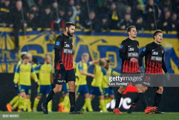 Tim Sparv Zsolt Korcsmar and Erik Sviatchenko of FC Midtjylland looking dejected during the Danish Alka Superliga match between FC Midtjylland and...