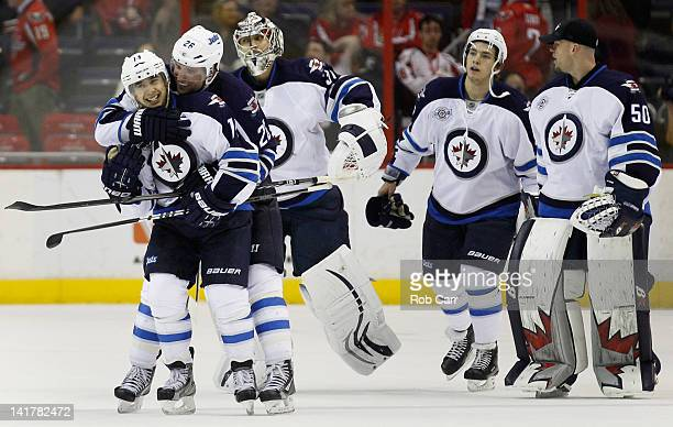 Tim Stapleton of the Winnipeg Jets is congratulated by teammate Blake Wheeler after scoring the game winning goal in overtime to defeat the...