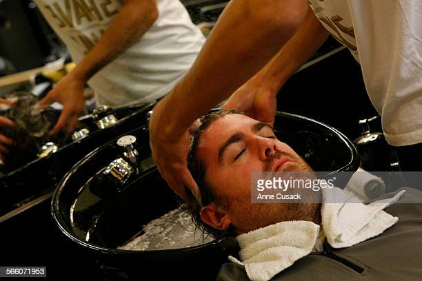 Tim Sullivan gets his hair washed at a new Barber shop in downtown Los Angeles called Bolt and opened by a 46 year old former marketing executive...