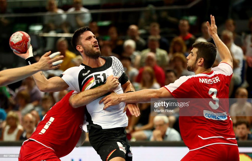 Tim Suton #51 of Germany challenges Lucas Meister #3 of Switzerland during the 2018 EHF European Championship Qualifier between Germany and Switzerland at OVB-Arena on June 18, 2017 in Bremen, Germany.