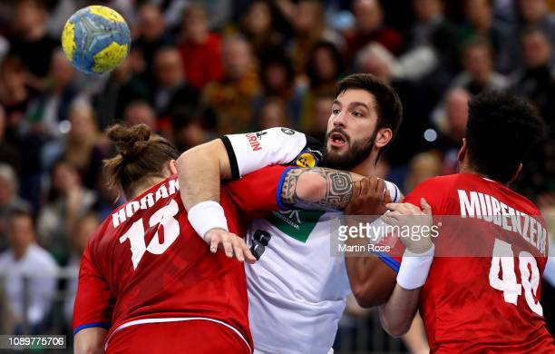 Tim Suton of Germany challenges Pavel Horak and Dieudonne Mubenzem of Czech Republic during the International Handball Friendly match between Germany...