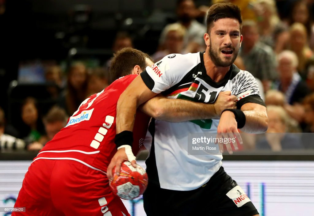 Tim Suton #51 of Germany challenges Roman Sidorowicz of Switzerland during the 2018 EHF European Championship Qualifier between Germany and Switzerland at OVB-Arena on June 18, 2017 in Bremen, Germany.