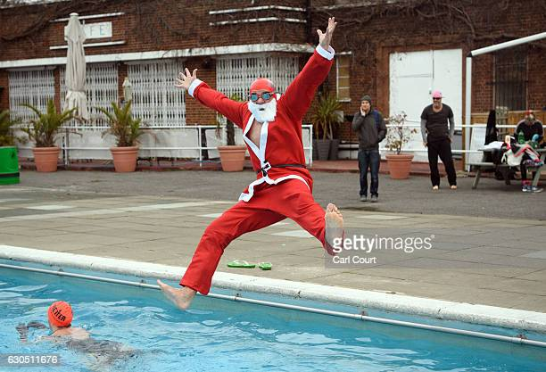 Tim Sutton poses for a photograph as he jumps into the pool for a Christmas Day swim at Brockwell Lido on December 25 2016 in London England Winter...