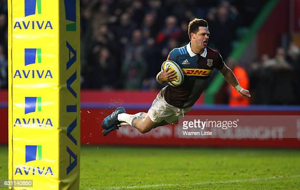 Tim Swiel of Harlequins dives over to score a try during the Aviva Premiership match between Harlequins and Sale Sharks at Twickenham Stoop on...