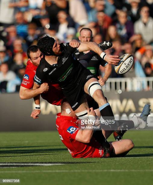 Tim Swinson of Glasgow Warriors is tackled by Rob Evans of Scarlets during the Guinness Pro14 Semi Final match between Glasgow Warriors and Scarlets...