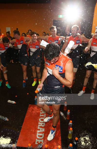 Tim Taranto of the Giants is soaked by team mates after victory in the round two AFL match between the Greater Western Sydney Giants and the Gold...