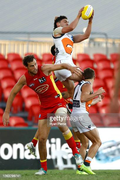Tim Taranto of the Giants marks during the round nine AFL match between Gold Coast Suns and the Greater Western Sydney Giants at Metricon Stadium on...