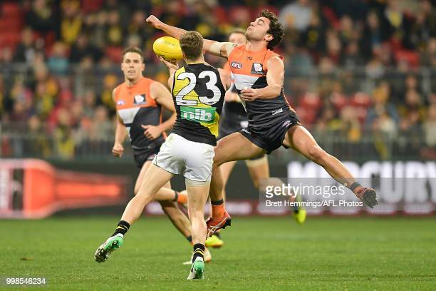 Tim Taranto of the Giants spoils a Kane Lambert of the Tigers mark during the round 17 AFL match between the Greater Western Sydney Giants and the...