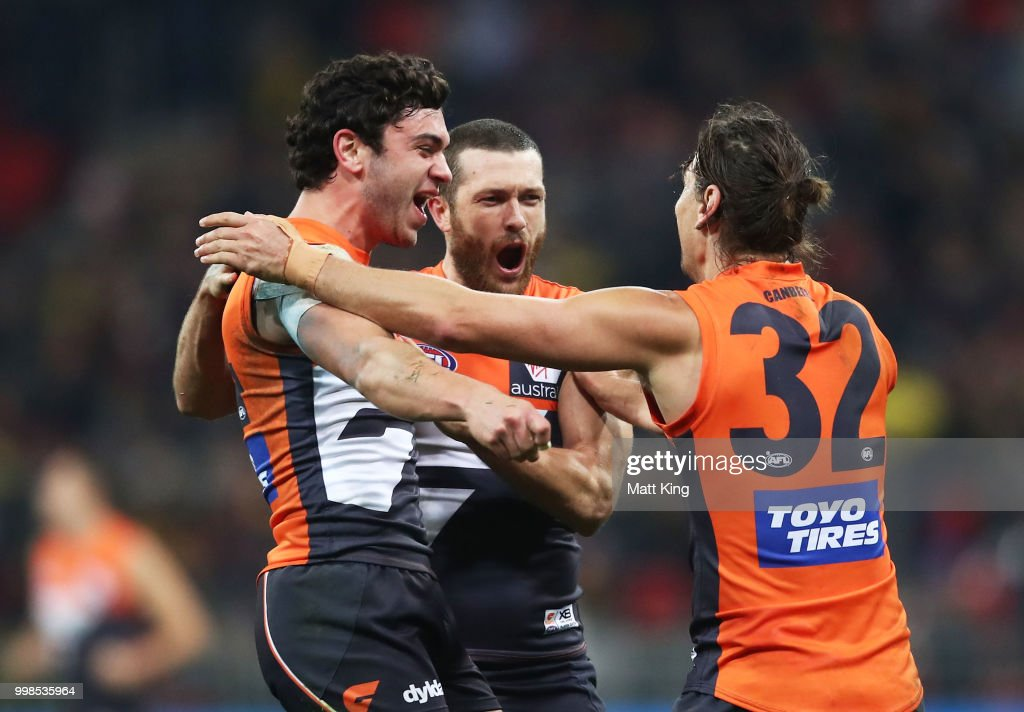 Tim Taranto, Sam Reid and Ryan Griffen of the Giants celebrate victory at fulltime during the round 17 AFL match between the Greater Western Sydney Giants and the Richmond Tigers at Spotless Stadium on July 14, 2018 in Sydney, Australia.