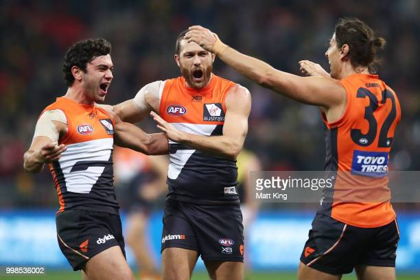 Tim Taranto Sam Reid and Ryan Griffen of the Giants celebrate victory at fulltime during the round 17 AFL match between the Greater Western Sydney...