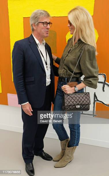 Tim Taylor and Claudia Schiffer attend the Frieze Art Fair VIP Preview in Regent's Park on October 2, 2019 in London, England.