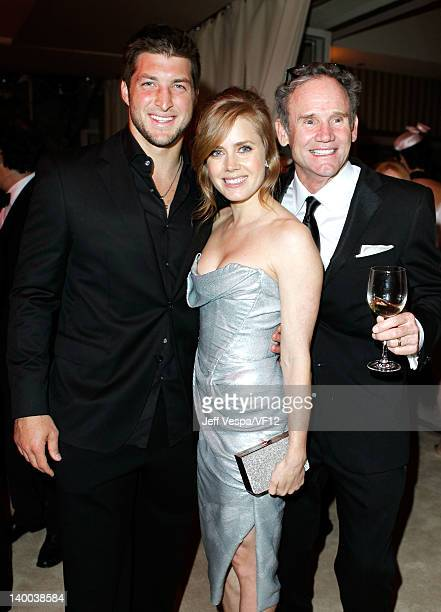 Tim Tebow Amy Adams and Bo Welch attend the 2012 Vanity Fair Oscar Party Hosted By Graydon Carter at Sunset Tower on February 26 2012 in West...