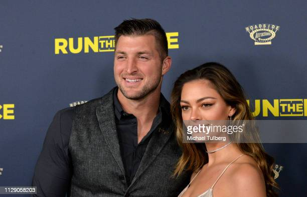 "Tim Tebow and Demi-Leigh Nel-Peters attend the premiere of Roadside Attractions' ""Run The Race"" at the Egyptian Theatre on February 11, 2019 in..."