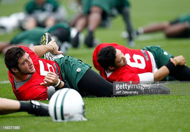 Tim Tebow and Mark Sanchez of the New York Jets work out at an organized team activity at the New York Jets Atlantic Health Jets Training Center on...