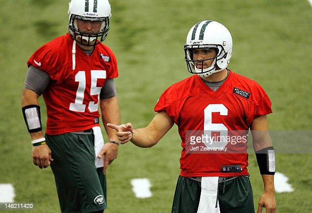 Tim Tebow and Mark Sanchez of the New York Jets work out during the first day of mini camp at the New York Jets Atlantic Health Training Center on...