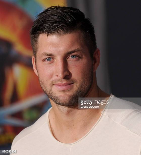 Tim Tebow arrives at the premiere of Disney and Marvel's Thor Ragnarok at the El Capitan Theatre on October 10 2017 in Los Angeles California