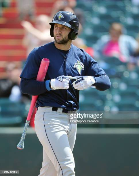 Tim Tebow of the Columbia Fireflies walks back to the dugout after striking out in the top of the sixth inning against the Lakewood BlueClaws on May...