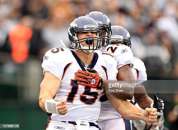 Tim Tebow of the Denver Broncos celebrates after he ran in for a touchdown against the Oakland Raiders at OaklandAlameda County Coliseum on December...
