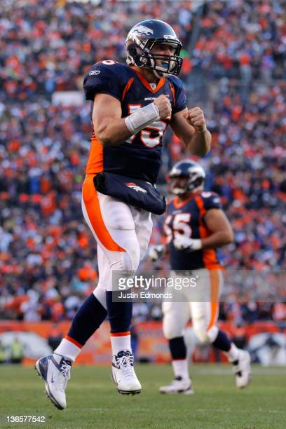 Tim Tebow of the Denver Broncos celebrates after running the ball in the end zone for a touchdown in the second quarter against the Pittsburgh...