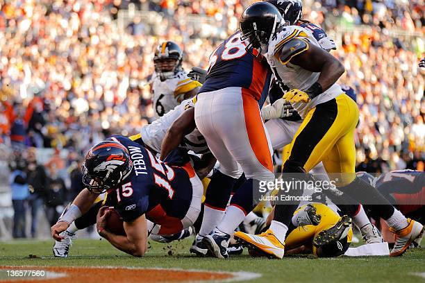 Tim Tebow of the Denver Broncos runs the ball for a touchdown in the second quarter against the Pittsburgh Steelers during the AFC Wild Card Playoff...
