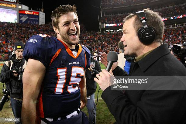 Tim Tebow of the Denver Broncos talks to the media after defeating the Pittsburgh Steelers in overtime of the AFC Wild Card Playoff game at Sports...
