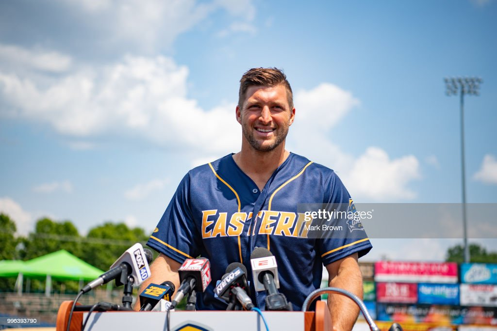 Tim Tebow #15 of the Eastern Division All-Stars answers questions from the media before the 2018 Eastern League All-Star Game at Arm & Hammer Park on July 11, 2018 in Trenton, New Jersey.