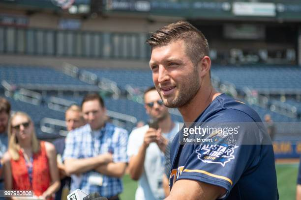 Tim Tebow of the Eastern Division AllStars answers questions from the media before the 2018 Eastern League All Star Game at Arm Hammer Park on July...