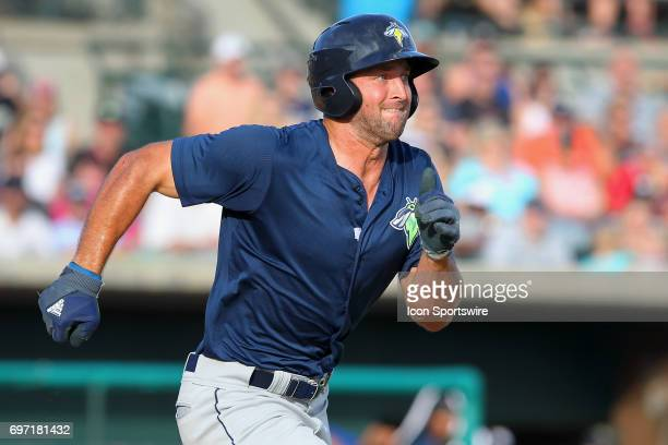 Tim Tebow of the Fireflies hustles to first base during the minor league game between the Columbia Fireflies and the Charleston RiverDogs on June 17...