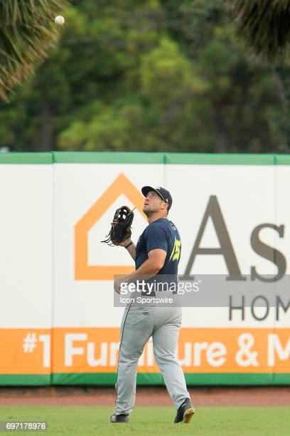 Tim Tebow of the Fireflies sets up to catch a fly ball during the minor league game between the Columbia Fireflies and the Charleston RiverDogs on...