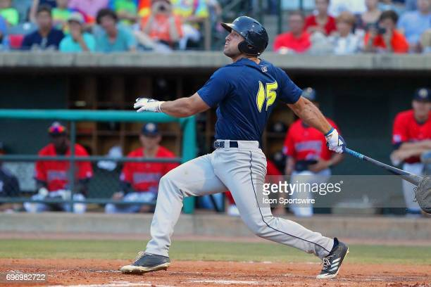Tim Tebow of the Fireflies watches the baseball after he puts the ball in play during the minor league game between the Columbia Fireflies and the...