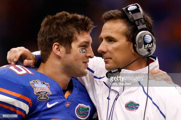 Tim Tebow of the Florida Gators hugs his head coach Urban Meyer after scoring a touchdown against the Cincinnati Bearcats during the Allstate Sugar...