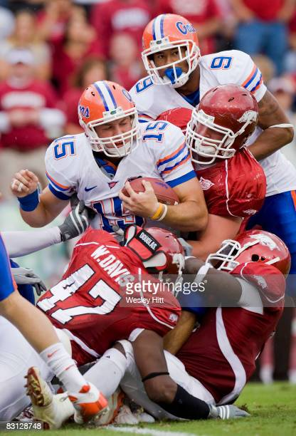 Tim Tebow of the Florida Gators is tackled by the defense of the Arkansas Razorbacks at Donald W Reynolds Stadium on October 4 2008 in Fayetteville...